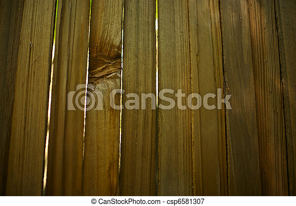 Fresh Wooden Fence with Light Shining Through - csp6581307