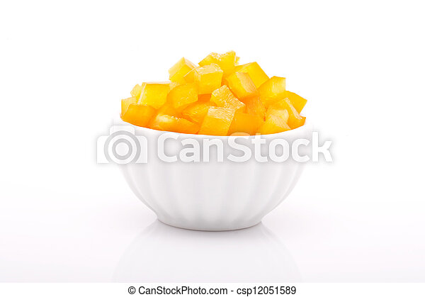 fresh yellow peppers in bowl isolated on white background - csp12051589