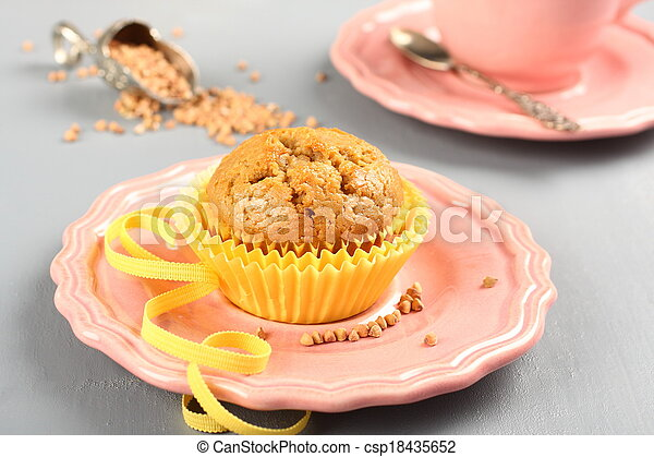 Freshly baked buckwheat muffins on the rose plate - csp18435652