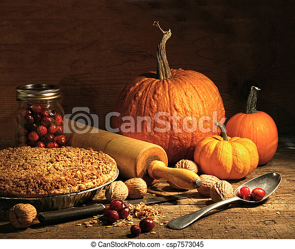 Freshly baked pie with pumpkin , nuts and cranberries - csp7573045