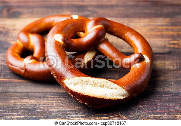 Freshly baked soft pretzel from Germany  - csp32718167