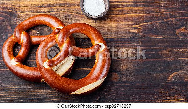 Freshly baked soft pretzel from Germany  - csp32718237