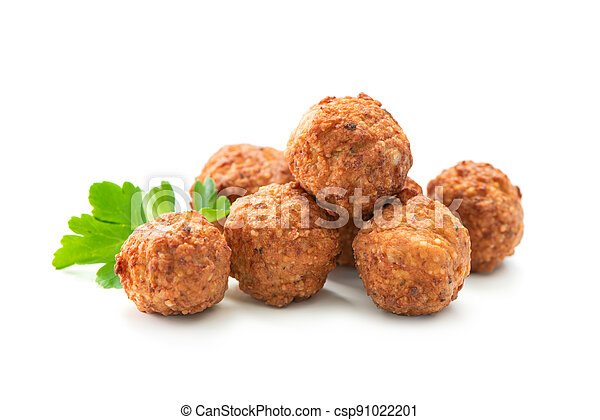 Fried meatballs with a parsley leaf isolated - csp91022201