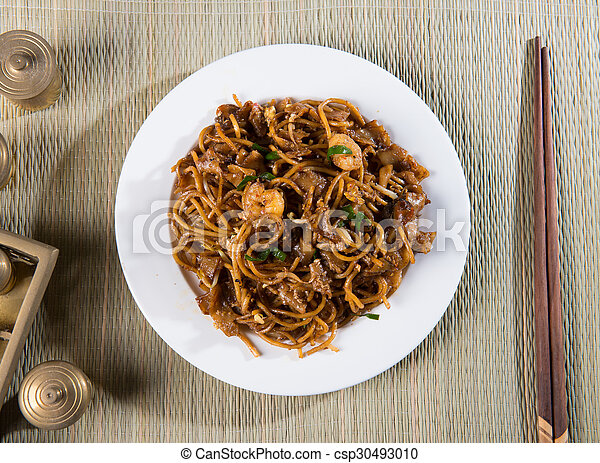 Fried Penang Char Kuey Teow top down view which is a popular noodle dish in Malaysia, Indonesia, Brunei and Singapore - csp30493010