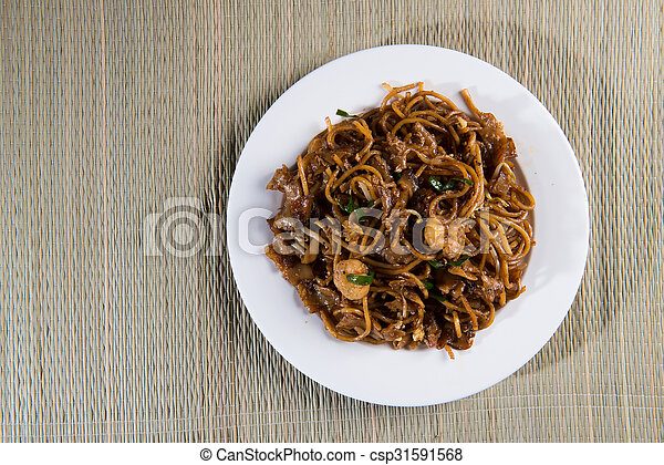 Fried Penang Char Kuey Teow top down view which is a popular noodle dish in Malaysia, Indonesia, Brunei and Singapore - csp31591568