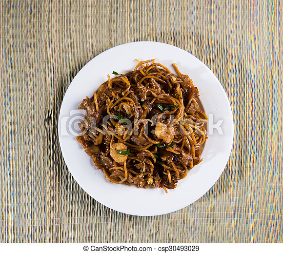 Fried Penang Char Kuey Teow top down view which is a popular noodle dish in Malaysia, Indonesia, Brunei and Singapore - csp30493029