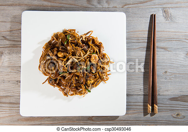 Fried Penang Char Kuey Teow top down view which is a popular noodle dish in Malaysia, Indonesia, Brunei and Singapore - csp30493046