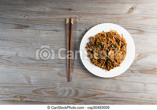 Fried Penang Char Kuey Teow top down view which is a popular noodle dish in Malaysia, Indonesia, Brunei and Singapore - csp30493009