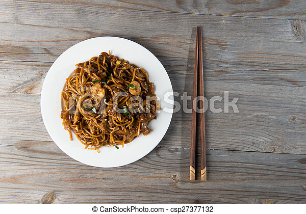 Fried Penang Char Kuey Teow top down view which is a popular noodle dish in Malaysia, Indonesia, Brunei and Singapore - csp27377132