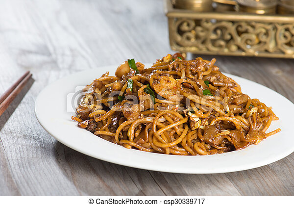 Fried Penang Char Kuey Teow which is a popular noodle dish in Malaysia, Indonesia, Brunei and Singapore - csp30339717