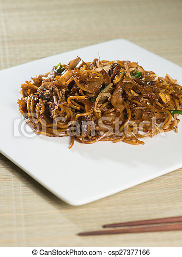 Fried Penang Char Kuey Teow which is a popular noodle dish in Malaysia, Indonesia, Brunei and Singapore - csp27377166