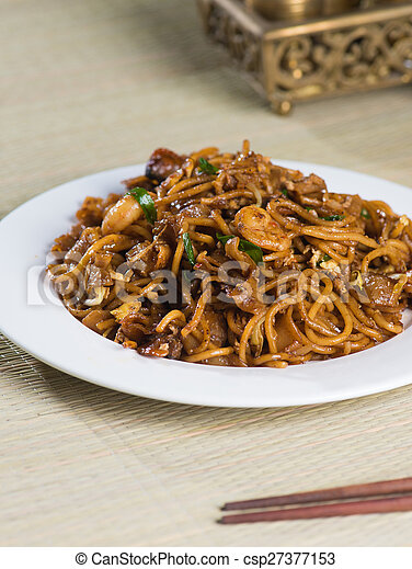 Fried Penang Char Kuey Teow which is a popular noodle dish in Malaysia, Indonesia, Brunei and Singapore - csp27377153