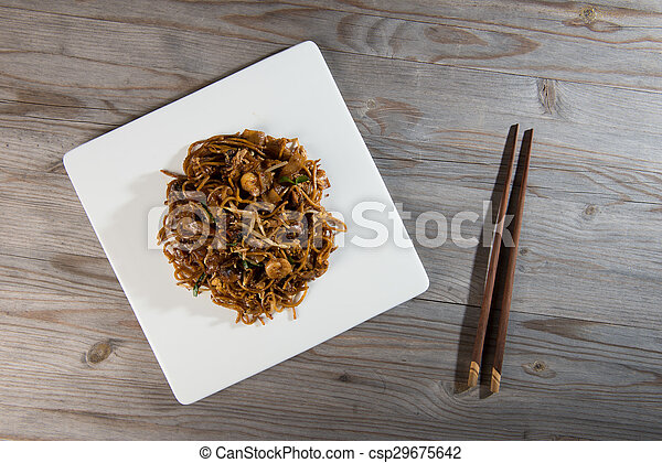 Fried Penang Char Kuey Teow which is a popular noodle dish in Malaysia, Indonesia, Brunei and Singapore - csp29675642