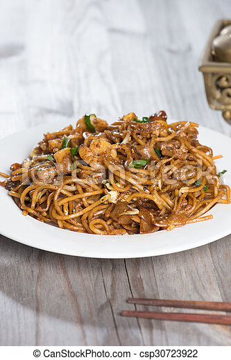 Fried Penang Char Kuey Teow which is a popular noodle dish in Malaysia, Indonesia, Brunei and Singapore - csp30723922