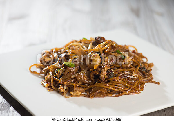 Fried Penang Char Kuey Teow which is a popular noodle dish in Malaysia, Indonesia, Brunei and Singapore - csp29675699