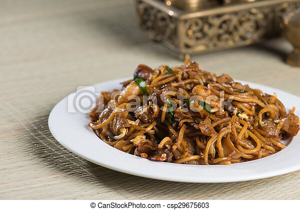 Fried Penang Char Kuey Teow which is a popular noodle dish in Malaysia, Indonesia, Brunei and Singapore - csp29675603