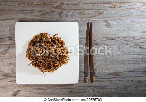Fried Penang Char Kuey Teow which is a popular noodle dish in Malaysia, Indonesia, Brunei and Singapore - csp29675703