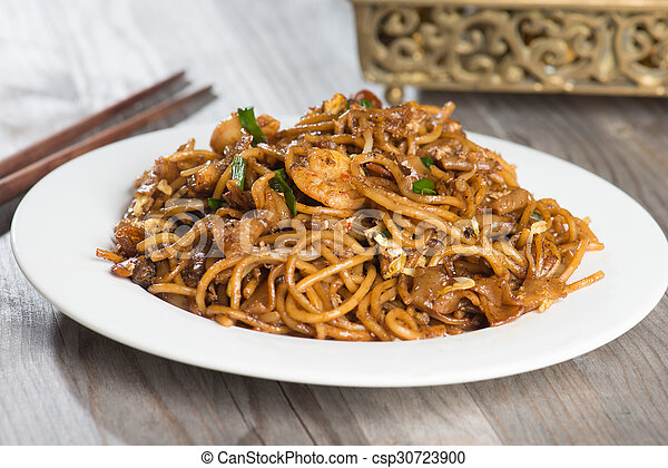 Fried Penang Char Kuey Teow which is a popular noodle dish in Malaysia, Indonesia, Brunei and Singapore - csp30723900