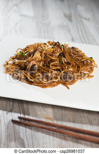 Fried Penang Char Kuey Teow which is a popular noodle dish in Ma - csp26981037