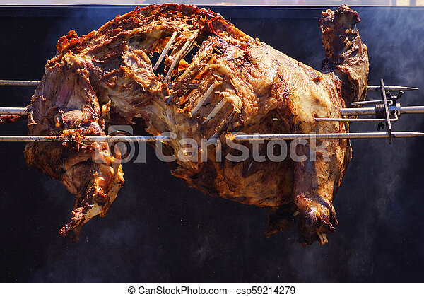 Fried pig on a spit - csp59214279