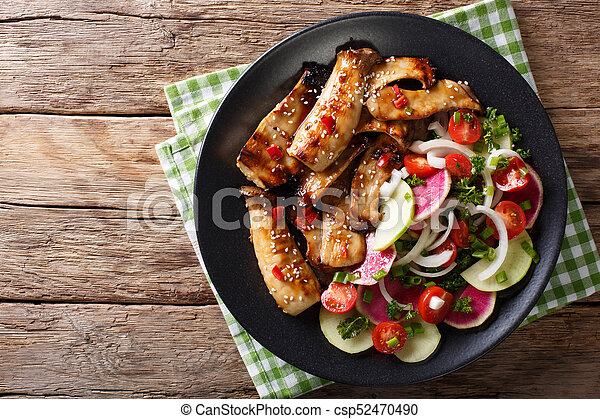 Fried spicy King Brown Mushroom with salad of radish and tomato close-up. horizontal top view - csp52470490