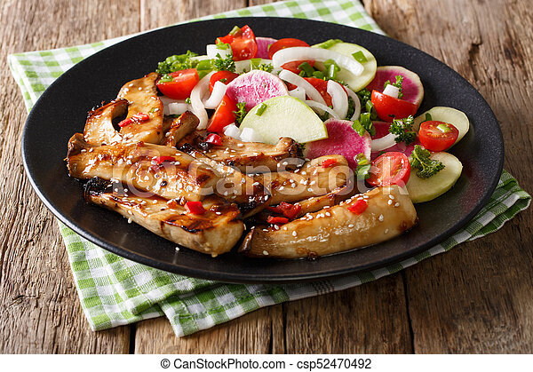 Fried spicy King Brown Mushroom with salad of radish and tomato close-up. horizontal - csp52470492