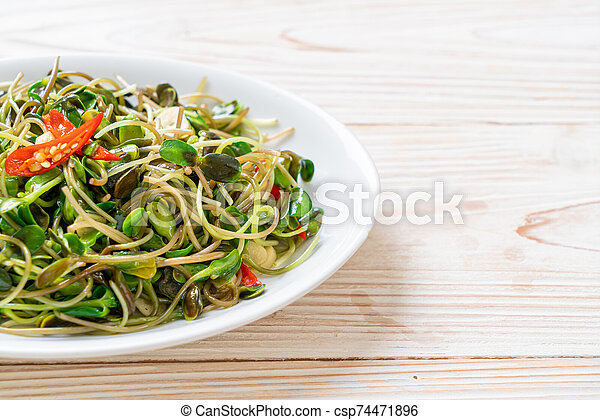 Fried Sunflower Sprout with Oyster Sauce - csp74471896