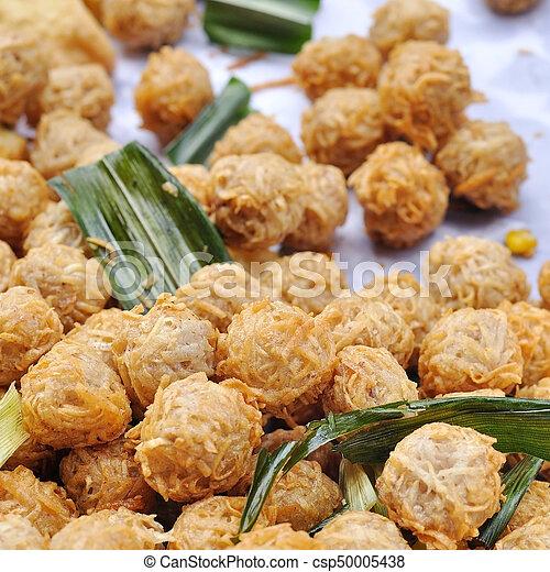 Fried taro ball in aluminium pot at Thailand market