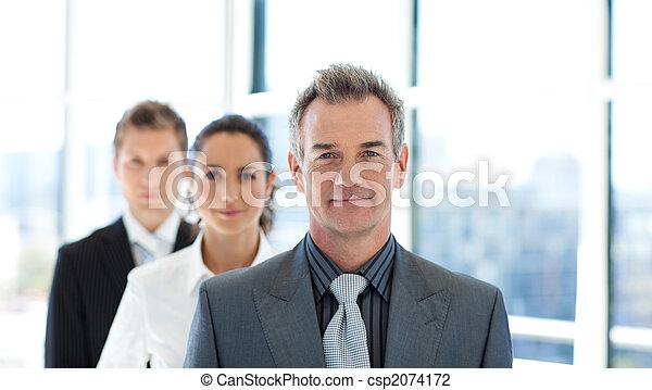 Friendly businessman leading a business team - csp2074172