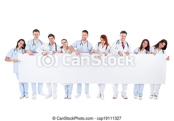 Friendly physicians holding a blank banner - csp19111327