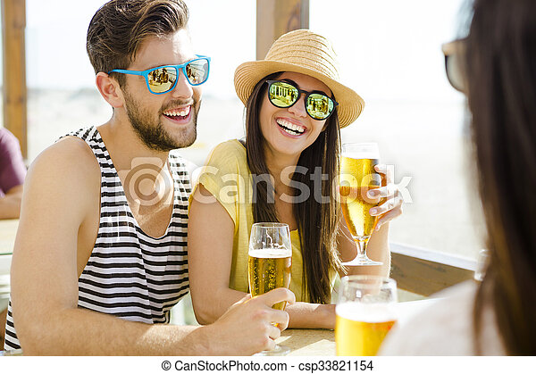 Friends drinking a cold beer - csp33821154