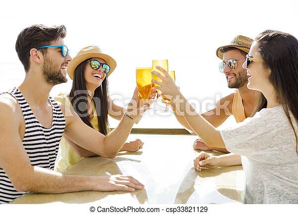 Friends drinking a cold beer - csp33821129