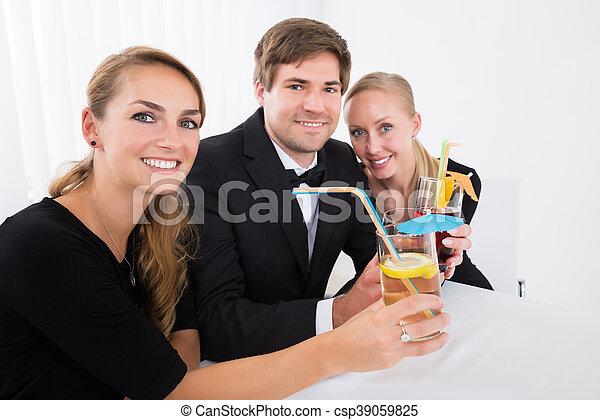 Friends Drinking Cocktails - csp39059825