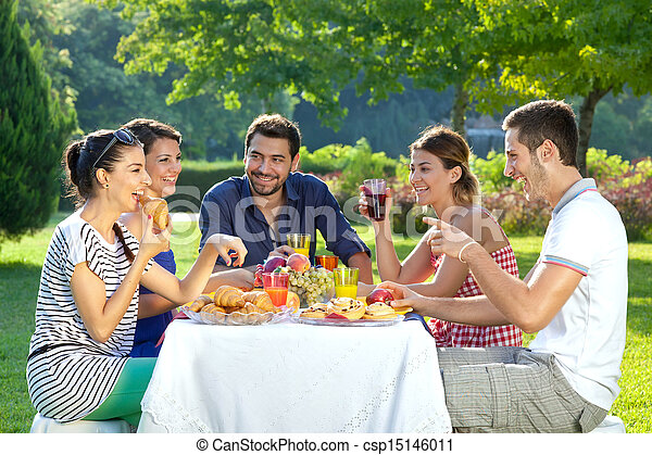 Friends enjoying a healthy outdoor meal - csp15146011