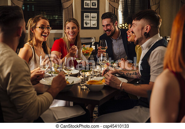 Friends Enjoying A Meal - csp45410133