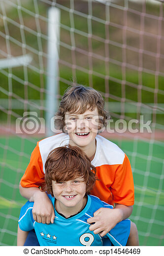 friends having fun on soccer field - csp14546469