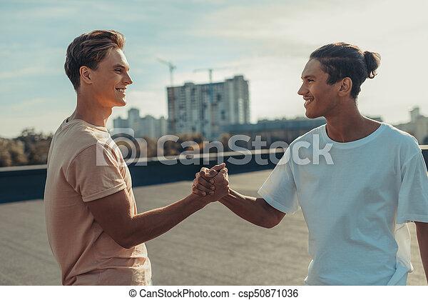 friends shaking hands - csp50871036