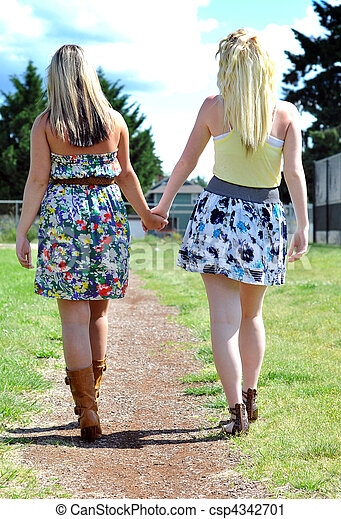Friends Walking and Holding Hands - csp4342701