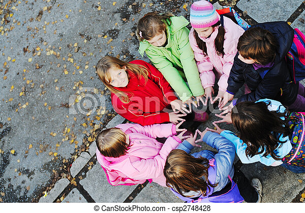 friendship and teamwork concept with young schoolgirls group - csp2748428