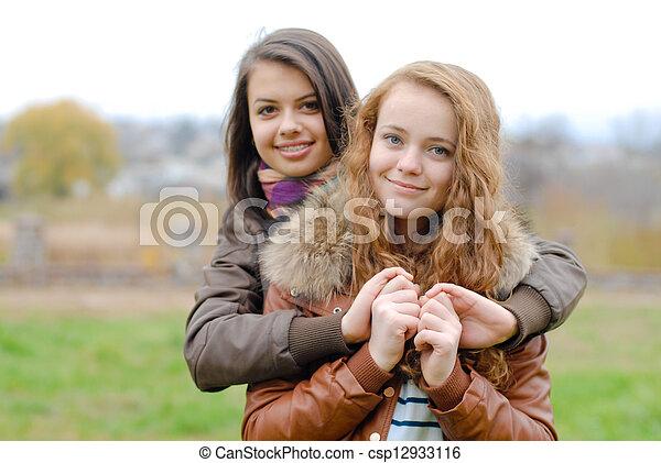 Friendship - Two best girlfriends hugging eachother - csp12933116