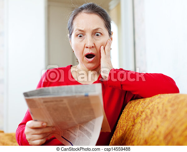 fright  woman with newspaper  - csp14559488