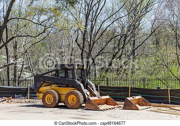 Front End Loader at Silt Fence - csp48164677