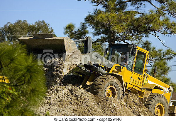 Front-end loader at work - csp1029446
