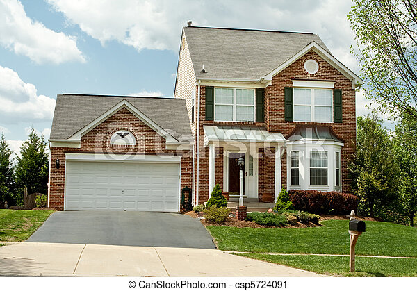Front of a new brick style single family home in suburban Maryland, USA.  Very small house for such a new building. - csp5724091