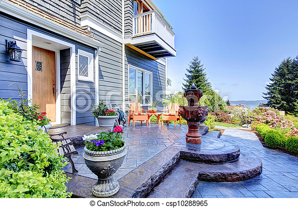 Front of the blue luxury house exterior with fountain. - csp10288965
