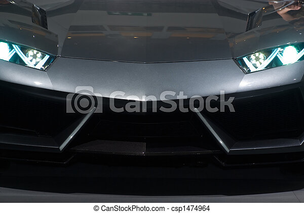 Front view of a luxury sport sedan isolated on black - csp1474964