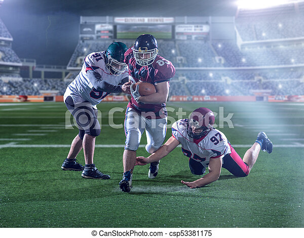 Front view of American football players in action - csp53381175