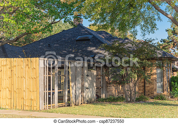 Front yard of corner house with wooden fence replacement in progress suburbs Dallas, Texas, USA - csp87237550