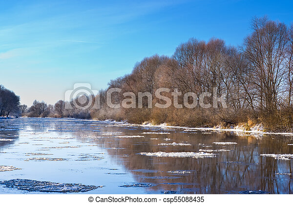 Frost on the trees on bank of river - csp55088435