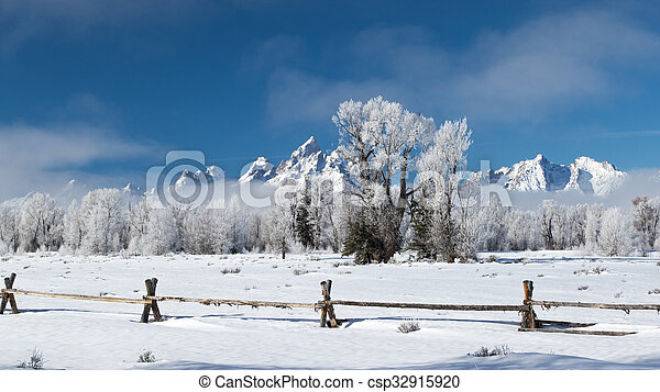 frosty ranch wooden fence jagged mountains - csp32915920